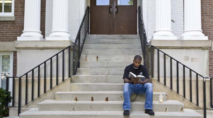 Student sitting on building steps